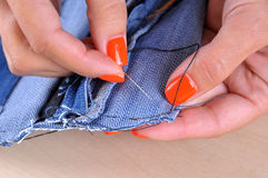 Process of handmade sewing with denim cloth and needle Stock Photo