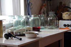 The process of harvesting the winter compote of dogwood. Compote of berries of dogwood in a clear jar on your Desk, storage for the winter Stock Photo