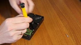 Process Of HDD Device Repair. Screwdriver unscrews the screw to repair the hard disk data recovery stock video