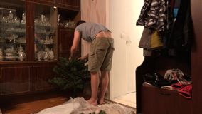 Process of installing an artificial Christmas tree time lapse video. Process of installing an artificial Christmas tree timelapse video. man puts a Christmas stock footage