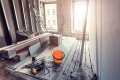 Process of installing pvc windows, drywall and tools in apartment is under construction, remodeling, renovation Royalty Free Stock Photos