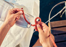 Process of knitting Bowline Stock Image