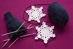 Process of knitting mittens on the needles Royalty Free Stock Image