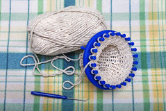 Process of knitting wool socks on a circular loom Stock Photography
