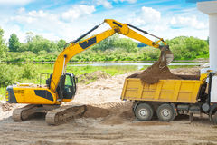 Process of loading of sand by exkavator Stock Photography