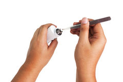Process of maintenance of the electronic Cigarette Royalty Free Stock Image