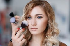 Process of the make-up artists work with the model Royalty Free Stock Photos