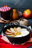 Process of making apple tart with pear jam and caramel Stock Image