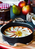 Process of making apple tart with pear jam and caramel Royalty Free Stock Images