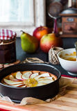 Process of making apple tart with pear jam and caramel Royalty Free Stock Photography