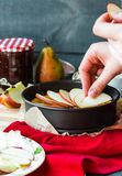 The process of making apple tart with pear jam, vertically Royalty Free Stock Photo