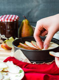 The process of making apple tart with pear jam, vertically. The process of making apple tart with pear jam,french dessert on a wooden board Stock Photography