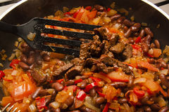 Process of making Chilli con carne. grilled meat and beans Royalty Free Stock Photo