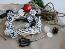 The process of making a Christmas wreath with his own hands. Advent wreath, or Advent crown, is a Christian tradition. Christmas preparations. The process of royalty free stock photography