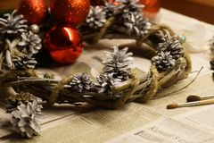 The process of making a Christmas wreath with his own hands. Advent wreath, or Advent crown, is a Christian tradition. Christmas preparations. The process of stock photo