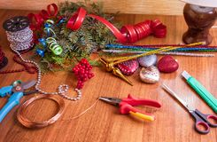 The process of making christmas wreath. The process of making handicraft christmas wreath, tools and decorations stock images