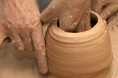 Process of making clayware on potter`s wheel Stock Photo