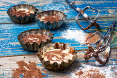 Process of making coffee cupcakes. Process of making coffee muffins on wooden countertop in rustic style.Photo tinted.Selective focus Royalty Free Stock Photo