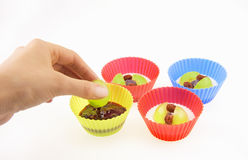 The process of making cupcakes with fruits Stock Images