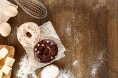 Donuts with ingredients for their preparation. The process of making donuts top view. Ingredients for frying the national American product Stock Photography