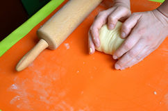 Process of making a dough from farina and butter on orange silicone pad.  Stock Photos