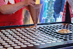 Process of making Dutch pancakes Royalty Free Stock Photo