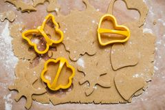 The process of making ginger cookies in the form of a heart, flower, butterfly and rabbit, gingerbread royalty free stock photo