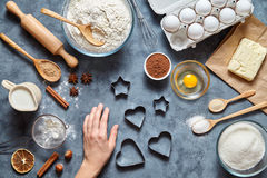 The process of making ginger cookies heart on Valentine`s Day. Woman` hand ready to knead the preparing  cake. Stock Photo