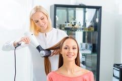 Process of making the hairdo stock photo