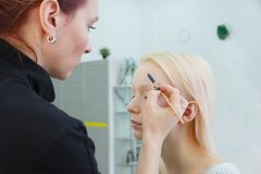 Process of making makeup. Make-up artist working with brush on model face stock photos