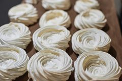 Process of making meringue pavlova dessert Food industry, mass or volume production. pastry chef making dessert.  stock images