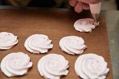 Process of making meringue pavlova dessert Food industry, mass or volume production. pastry chef making dessert.  royalty free stock image