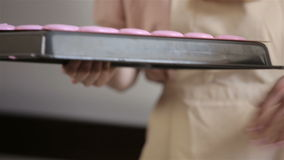 Process of making pink macaron. Two young women are preparing macaron stock video footage
