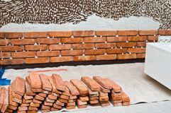 Process of making a red brick wall, home renovation royalty free stock image