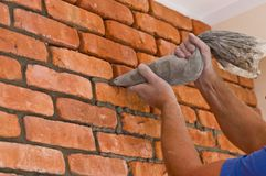 Process of making a red brick wall, home renovation stock images