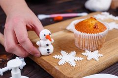 Process of making a snowman cupcake decoration of confectionery royalty free stock photos