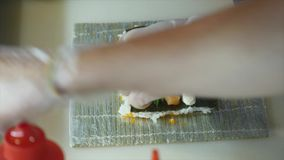 Process of making sushi rolls stock video
