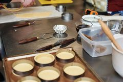 Process of making tart with salted caramel french dessert. Food industry, mass or volume production. Pastry chef making dessert royalty free stock photo