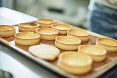 Process of making tart with salted caramel french dessert. Food industry, mass or volume production. Pastry chef making dessert royalty free stock photos