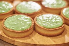 Process of making tart with salted caramel french dessert. Food industry, mass or volume production. Pastry chef making dessert stock photo