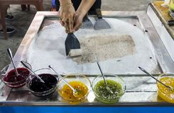 Process of making traditional fruit ice cream at night market stock image