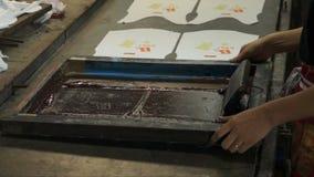 Process manual silk screening. Royalty Free Stock Photo
