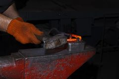 The process of manufacturing of horseshoes for horses in forge.  Royalty Free Stock Photo