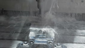 The process of manufacturing a metal part on a CNC milling machine. stock footage