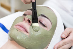 Process of massage and facials. In beauty salon stock photos