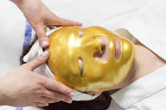 Process of massage and facials. In beauty salon Stock Photography