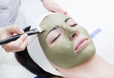Process of massage and facials. In beauty salon Royalty Free Stock Images