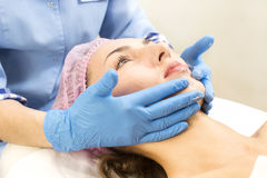 Process of massage and facials. In beauty salon Royalty Free Stock Photos