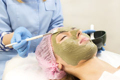 Process of massage and facials. In beauty salon Stock Image
