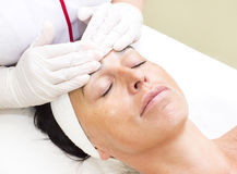 Process of massage and facials. In beauty salon Royalty Free Stock Photography
